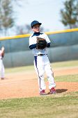 stock photo of little-league  - Little league baseball pitcher getting ready to throw the ball - JPG