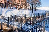 stock photo of perm  - bridge through a channel in a winter park city Perm Russia - JPG