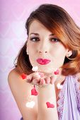 Portrait Of A Beautiful Woman Blowing Heart Kiss