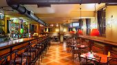 stock photo of public housing  - Interior of a modern pub in orange and wooden colors - JPG