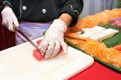Chef Cooking Japanese Sashimi At Buffet Dinner poster