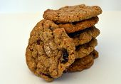 foto of baked raisin cookies  - stack of fresh homemade oatmeal cranberry raisin cookies - JPG