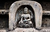 Bas relief statuette of sitting Buddha