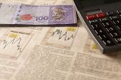 stock photo of ringgit  - Business investment concept of stock and share market with calculator and money