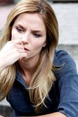 stock photo of bad mood  - Unhappy Depressed Woman frustrated and feeling down - JPG