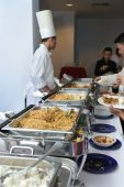 stock photo of chafing  - photograph of chef at buffet dinner situation