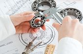 image of mechanical drawing  - tools and mechanisms detail on the background of technical drawings - JPG