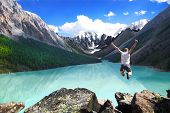 picture of jumping  - Mountain landscape with the lake and the jumping man - JPG