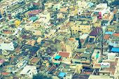 foto of trichy  - Vintage retro style image of colorful homes in crowded Indian city Trichy India Tamil Nadu - JPG