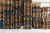 picture of wooden pallet  - Used wooden Euro pallets in distribution warehouse - JPG