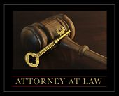 Attorney at law- judge's gavel and a skeleton key in a portrayal of law and justice.