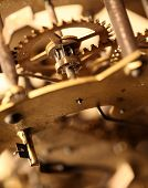 foto of wind up clock  - Close up of an internal clock mechanism