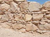 stock photo of masada  - Wall of Herods castle in fortress Masada Israel - JPG