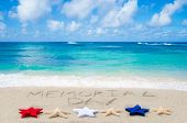 stock photo of democracy  - Memorial day background on the sandy beach near ocean - JPG