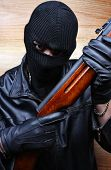 stock photo of terrorist  - Gangster terrorist boss mafia criminal with a gun - JPG