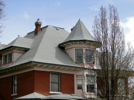 stock photo of gabled dormer window  - This Queen Anne mansion was constructed during 1900 and became a well known landmark in Weiser, Idaho. ** Note: Visible grain at 100%, best at smaller sizes - JPG