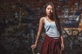 picture of skate board  - Beautiful Asian teen girl with skate board - JPG