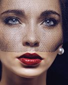 picture of grieving  - beauty brunette woman under black veil with red manicure close up - JPG