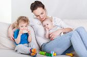 picture of mums  - Mum with baby and preschooler sitting on sofa - JPG