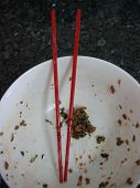 picture of wanton  - Homemade chinese dumpling or wanton preparation. Left over meat on bowl.