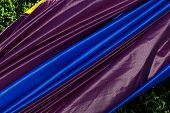 foto of nylons  - Closeup of purple and blue nylon fabric for a hot - JPG