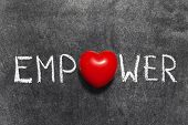 stock photo of empower  - empower word handwritten blackboard with heart symbol instead of O - JPG