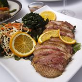 stock photo of duck breast  - Roast Duck Breast with Orange sauce and Vegetable - JPG