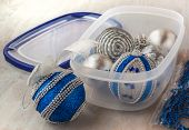 image of box-end  - Box with silver and blue Christmas balls on a gray background - JPG