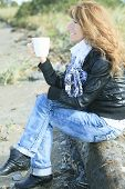stock photo of 55-60 years old  - Cofee Woman Tree Trunk - JPG