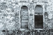 foto of niche  - abstract fragment of monochrome tone of an old brick wall with window niches - JPG