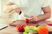 stock photo of hand cut  - cooking and home concept  - JPG