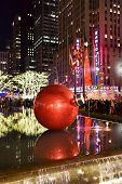 stock photo of rockefeller  - NEW YORK CITY - DEC. 25 2014: New York City landmark Radio City Music Hall in Rockefeller Center decorated with Christmas decorations in Midtown Manhattan NYC.