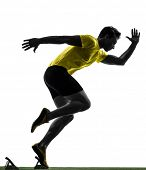 stock photo of sprinter  - one  man young sprinter runner in starting blocks silhouette studio on white background - JPG