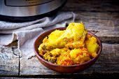 picture of stew pot  - Stewed chicken with potato in the crock - JPG