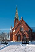 foto of evangelism  - The Evangelical Lutheran Church of red brick on the background of blue sky in the Finnish town of Forssa - JPG