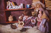 picture of charming  - Cute charming little lady with dolls. Retro style. ** Note: Shallow depth of field - JPG