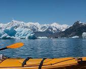 image of kayak  - A kayak navigates Alaska - JPG