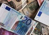 stock photo of depreciation  - dollar and euro notes - JPG