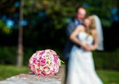 foto of bouquet  - Wedding couple and flower bouquet on a wedding day - JPG