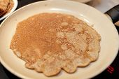 stock photo of flaxseeds  - Pan with flaxseed meal pancake at home