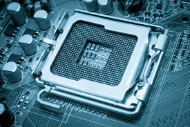 stock photo of cpu  - Empty CPU processor socket with pins on motherboard toned blue - JPG