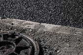 pic of manhole  - Urban road under construction asphalting in progress - JPG