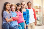 image of pre-adolescent child  - Group Of Children Hanging Out Together In Mall - JPG