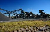picture of crusher  - Crusher used to make flat rock for road material - JPG