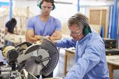 picture of senior class  - Student And Teacher In Carpentry Class Using Circular Saw - JPG