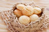 stock photo of wooden basket  - Brazilian snack cheese bread  - JPG