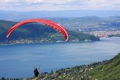 foto of annecy  - paraglider flying above Lake Annecy in France - JPG