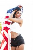 picture of independent woman  - Sexy woman holding usa flag outdoor fourth of july independence day - JPG