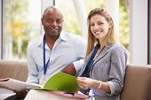 stock photo of tutor  - Portrait Of Two College Tutors Having Discussion Together - JPG