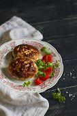 foto of pork cutlet  - cutlets of pork with vegetable salad on dark wooden surface - JPG